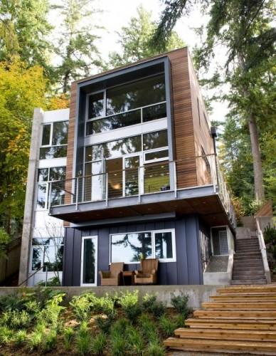 Maison contemporaine en bois et en béton, 2 étages et belle ouverture sur le jardin